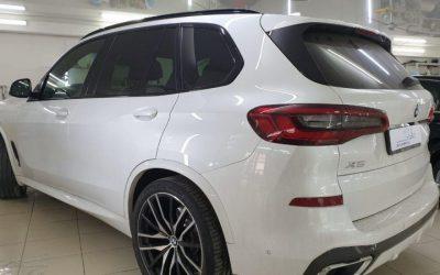 BMW X5 — установка защитной сетки в бампер и тонировка передних боковых стекол пленкой Global 50%