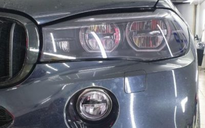 Тонировка фар и туманок полиуретановой пленкой Stek — BMW X5