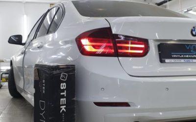 Бронирование задних фонарей автомобиля BMW 3 series пленкой Stek