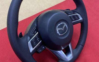 Перетянули руль от Mazda 6 экокожей немецкого производства с псевдоперфорацией